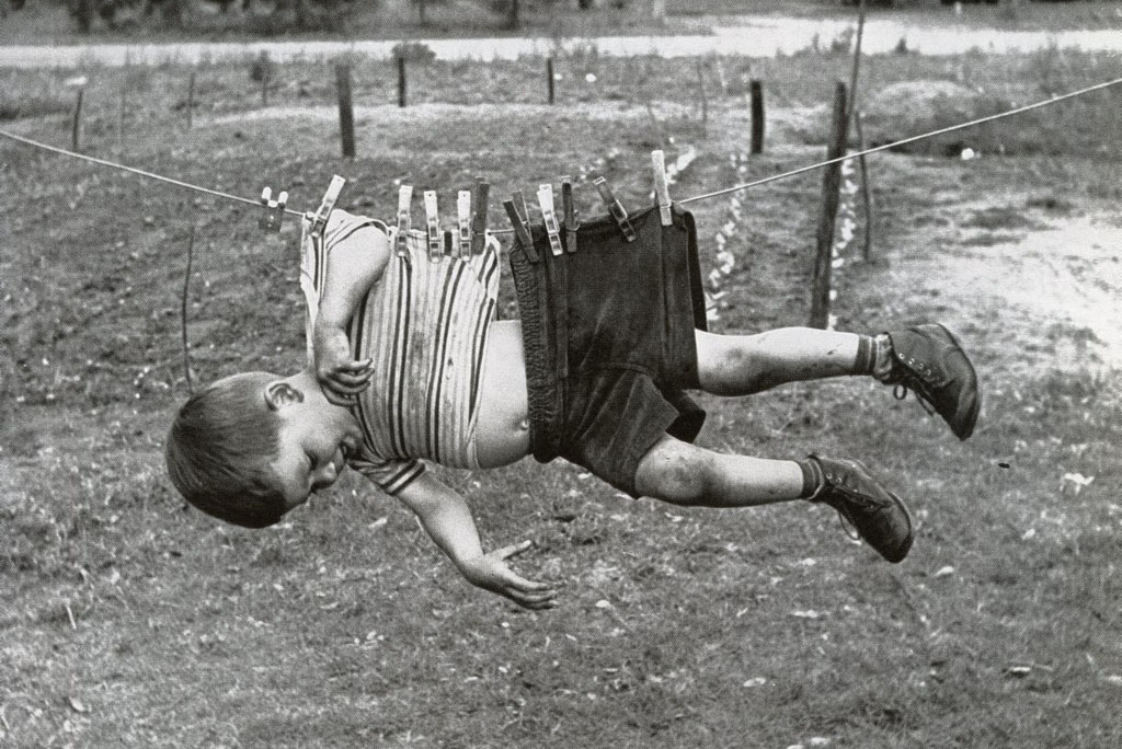 Boy on clothesline  ca. 1950s 60s