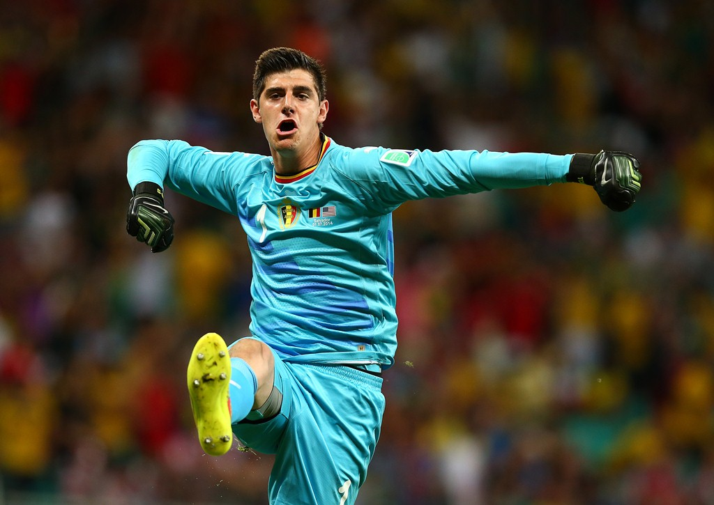 Belgium goalkeeper thibaut courtois celebrates the opening goal