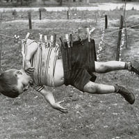 Thumb boy on clothesline  ca. 1950s 60s