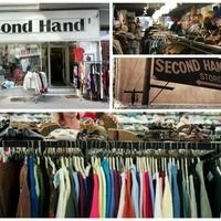 Thumb shopping for clothing in second hand store.jpg